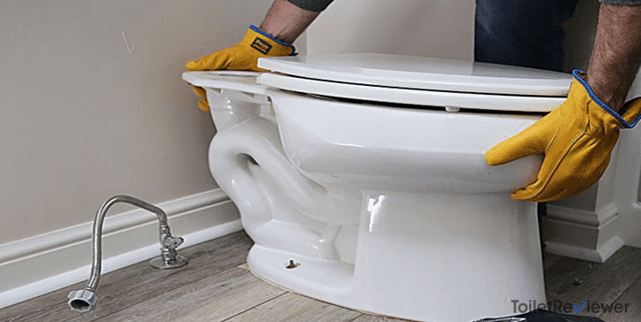 plumber installing a new toilet