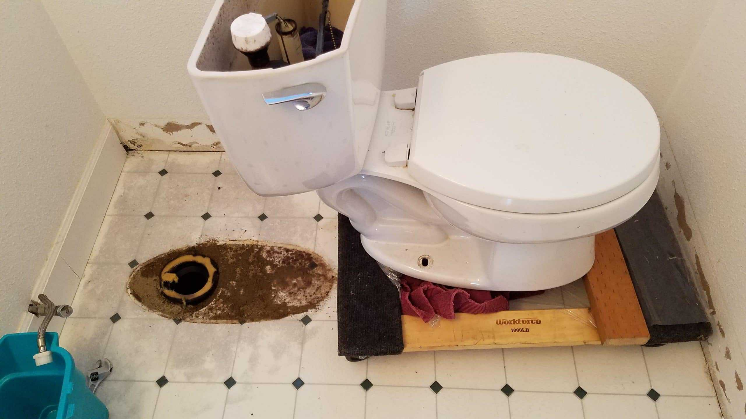 removal of old toilet and plumber is ready to install a new one