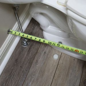ruler measurements of a new rough in for toilet
